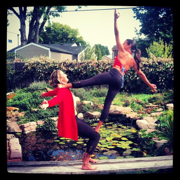 Adi Carter and Raquel doing acro yogo in Beckons Yoga Clothing